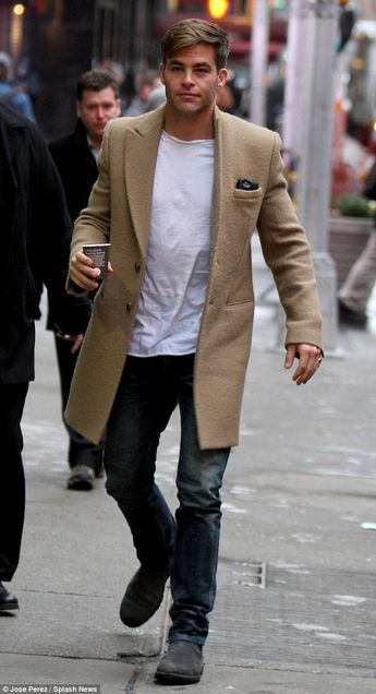 Chris Pine is every bit the stylish hunk as flashes smile in New York