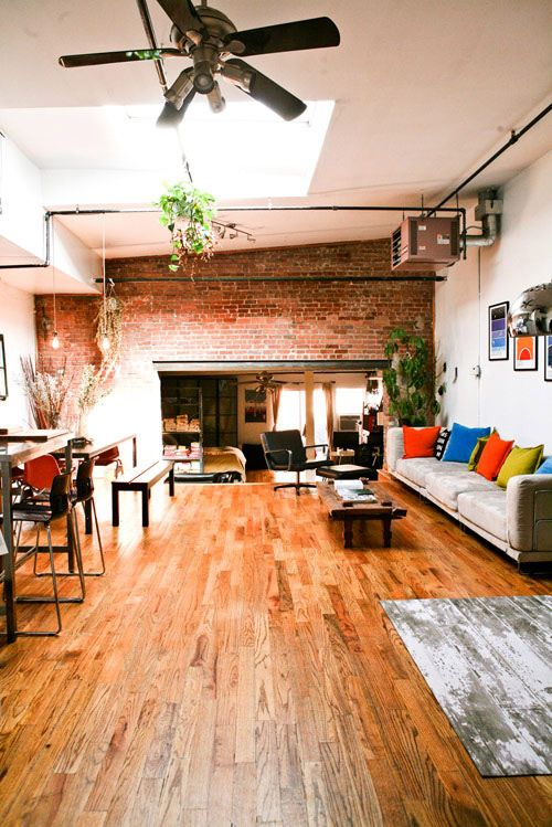 Floors, exposed brick, industrial touches.