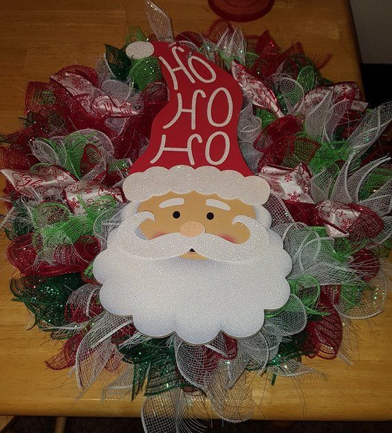 Beautiful hand made deco mesh wreath Accented with a Santa plaque