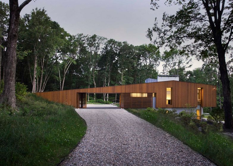 Bridge House has a living room that straddles its sloping site h