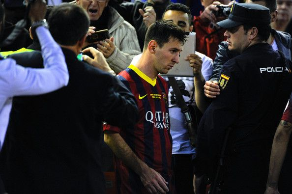Lionel Messi of FC Barcelona looks down after being defeated during the Copa del Rey Final between Real Madrid and FC Barcelona at Estadio Mestalla on April 16, 2014 in Valencia, Spain.