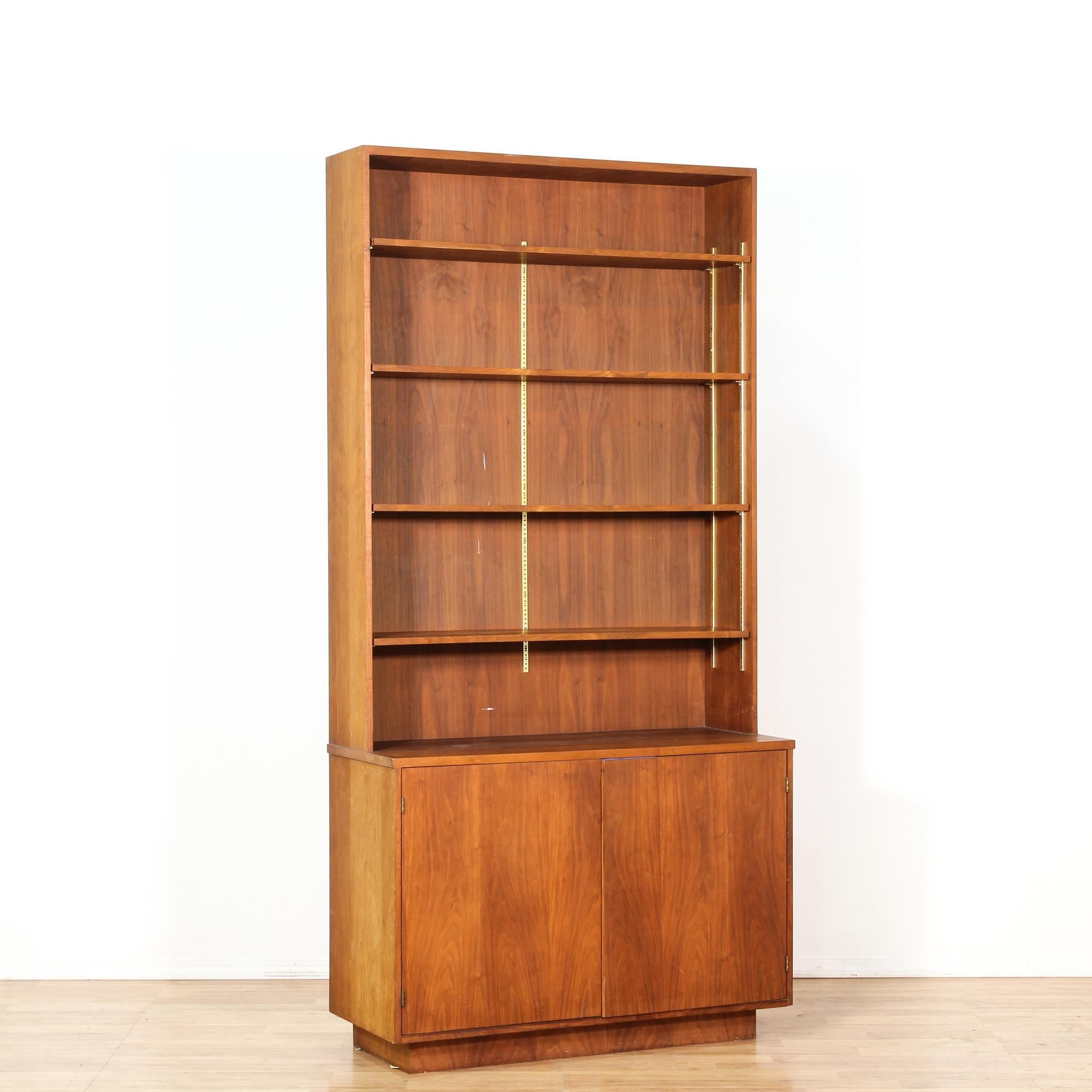 This danish modern style bookcase is featured in a solid wood with a