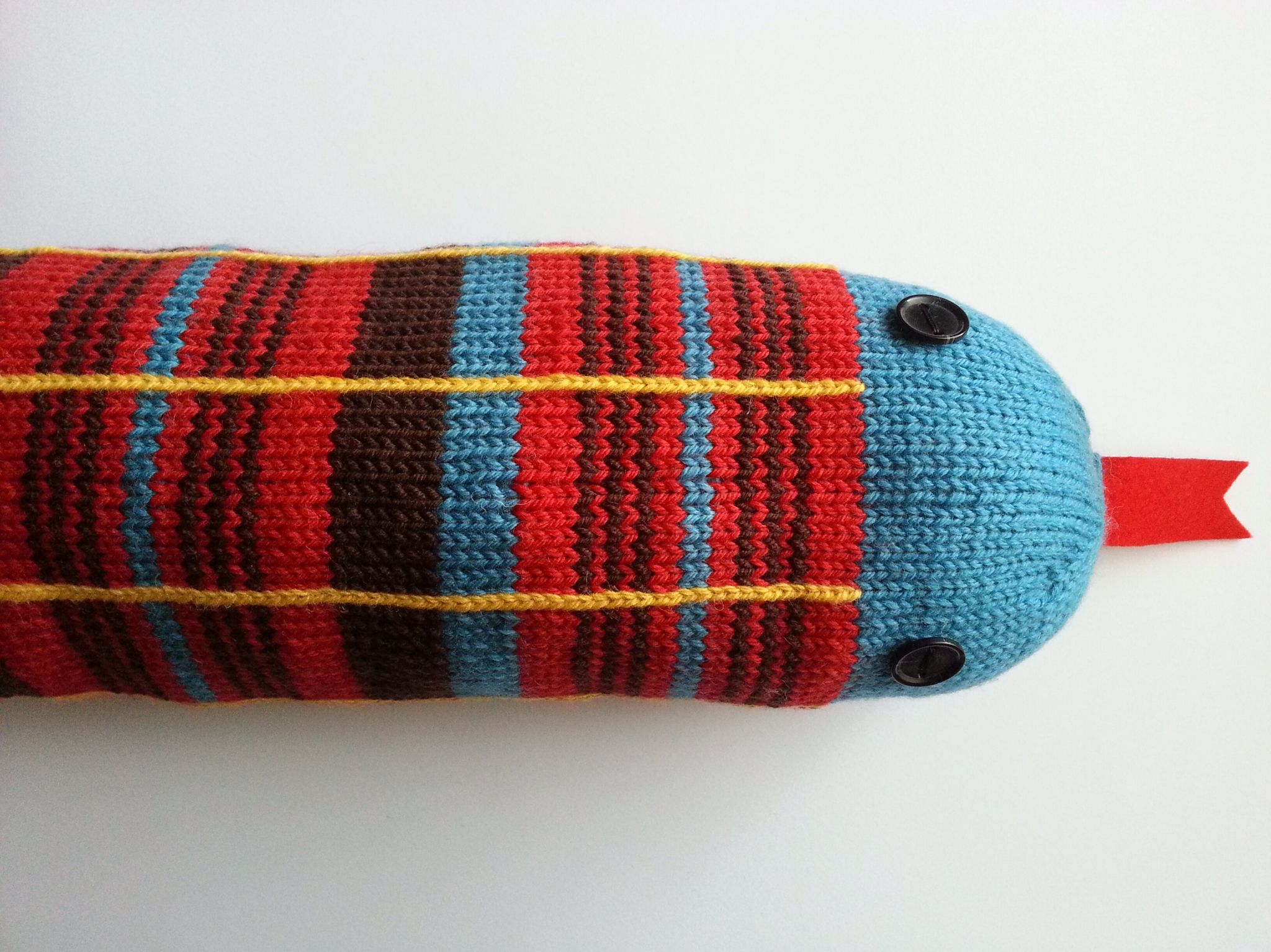 Draught excluder knitted in Routemaster moquette pattern ...