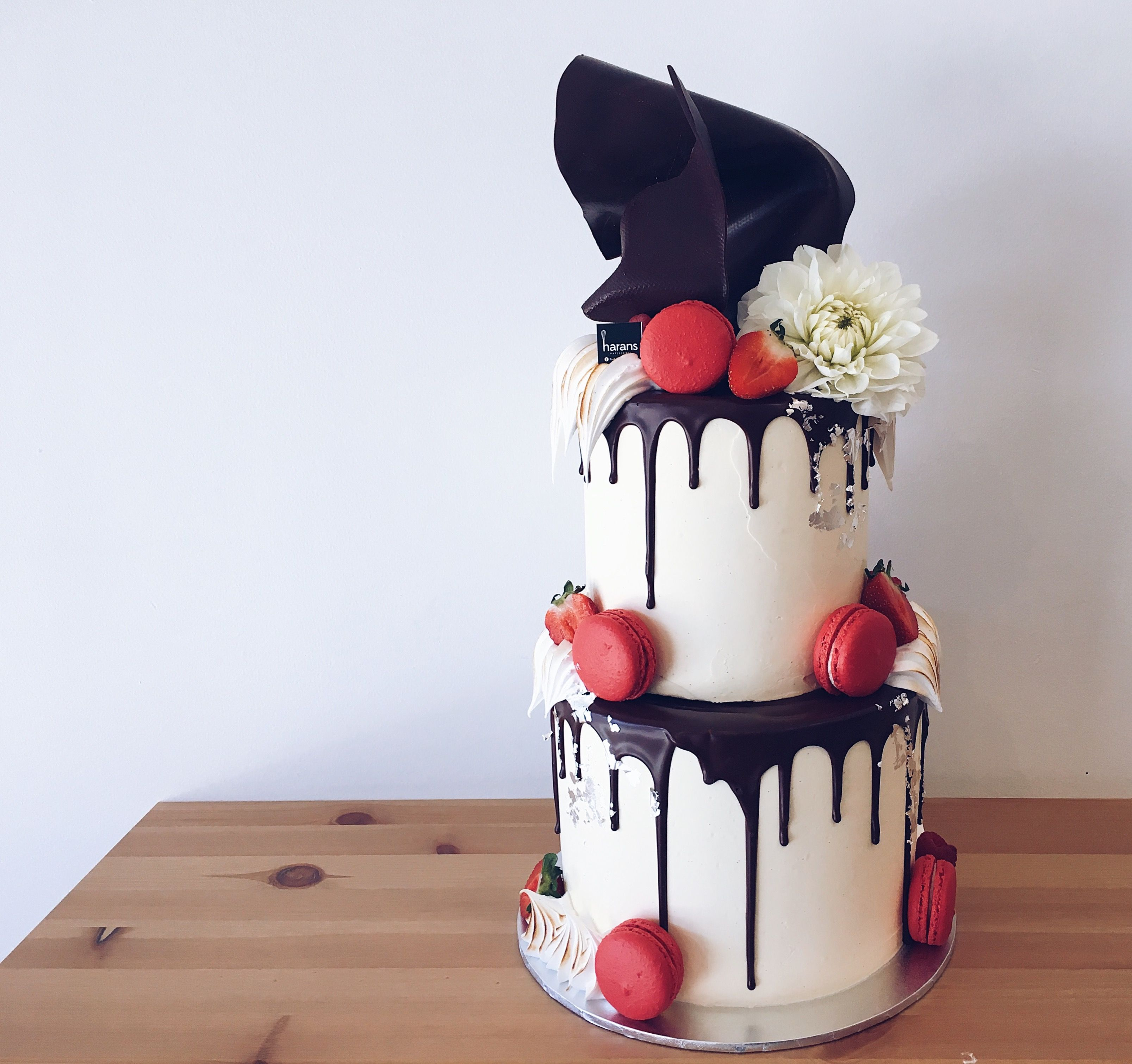 Black white cake with dark chocolate drip red macarons white black white cake with dark chocolate drip red macarons white flowers touches mightylinksfo Image collections