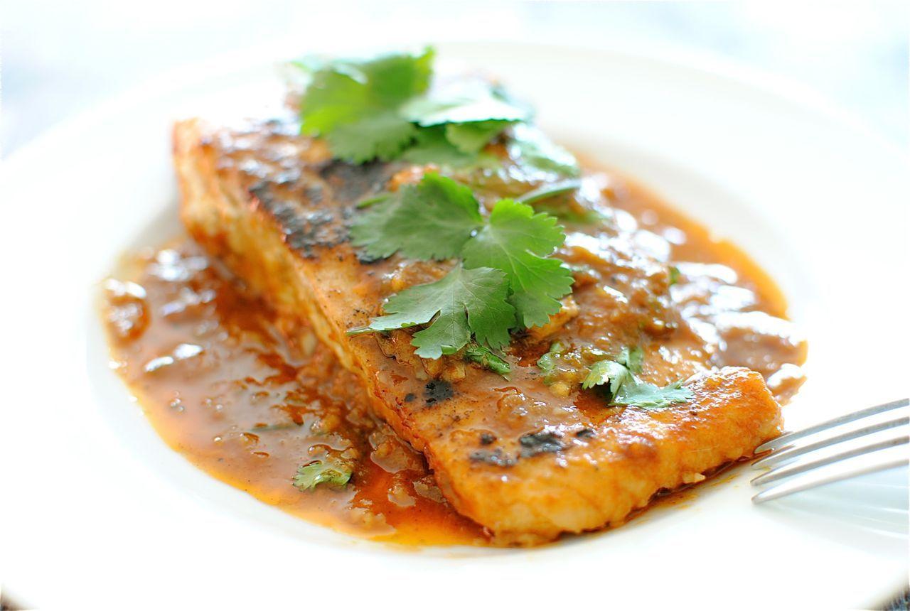 Salmon in spicy garlic tomato sauce