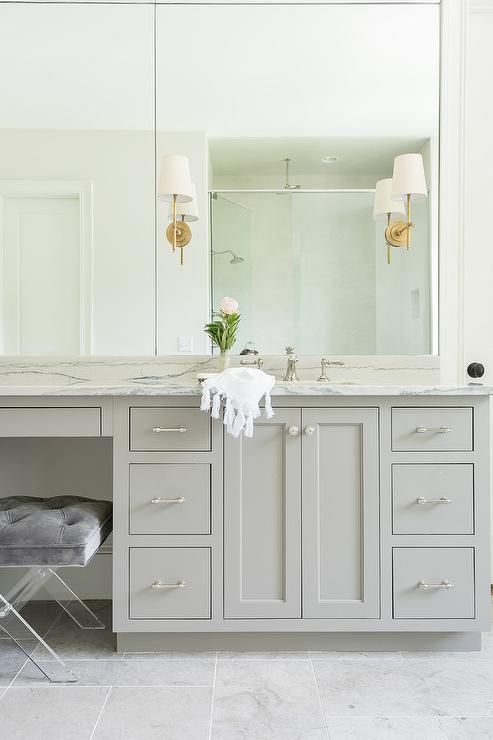Thomas OBrien Bryant Sconces Mounted To Multipanel Vanity Mirrors - Sconces mounted on bathroom mirror