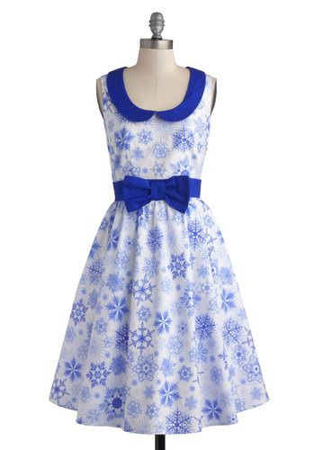 Celebrate the season in style with glittery, ice blue snowflakes and a bow adorned waist