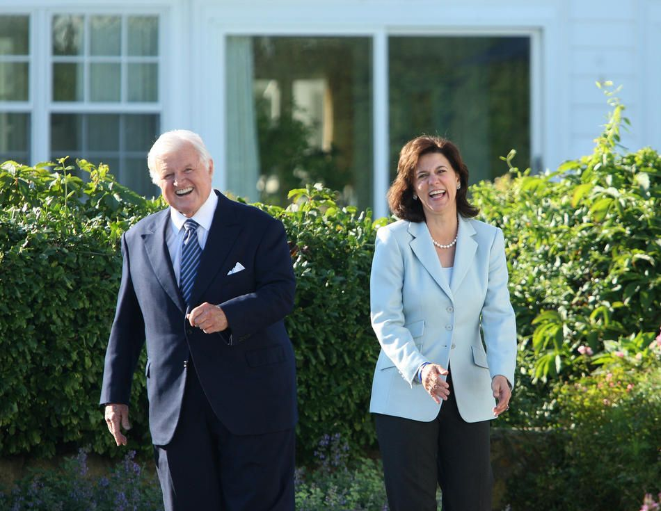Sen. Edward Kennedy with his wife Victoria Reggie as they joked around with members of the media as they waited for the arrival of President Michelle Bachelet of Chile in Hyannisport, Sept. 23, 2008. (Essdras M. Suarez/The Boston Globe)