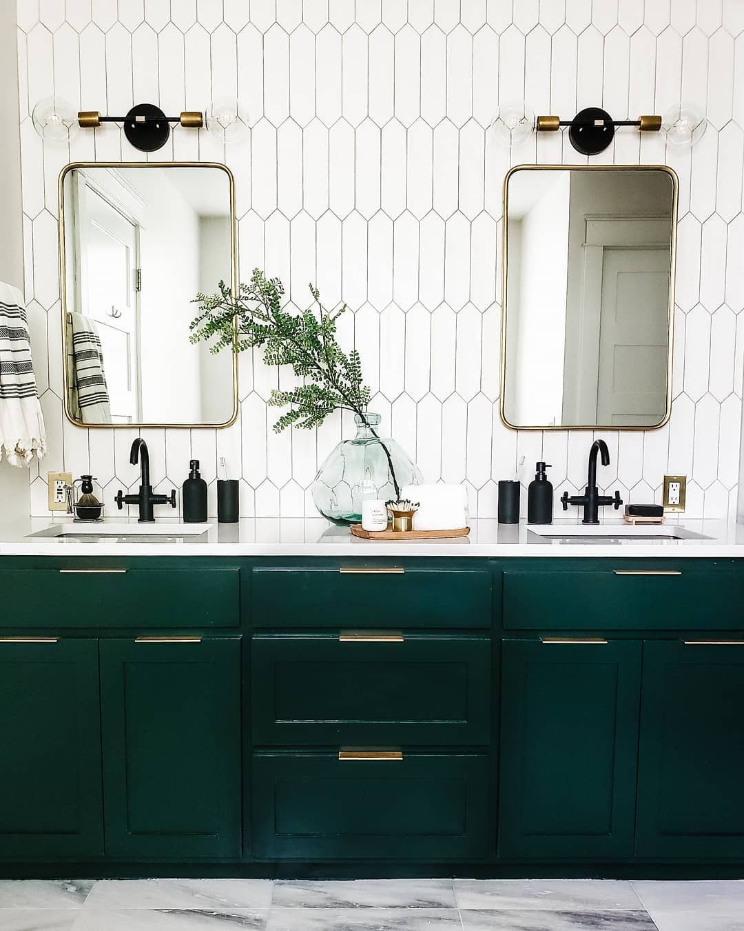 """Photo of Mackenzie Craven on Instagram: """"Shiny Essex Green cabinets by @benjaminmoore – and more! —  From the grout color to the lightbulbs, all things bathroom remodel are now…"""""""