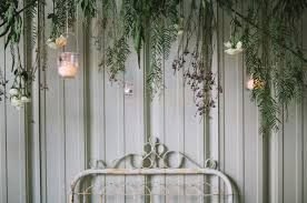 Foliage hanging back drop a obviously yours would be bigger/longer then this. With a mix of foliages, soli with glass globe tea lights & mini succulents
