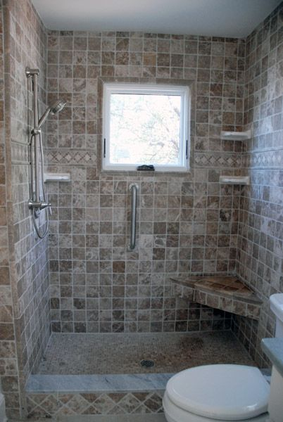 Tiled Shower Stall With Corner Bench And Window In
