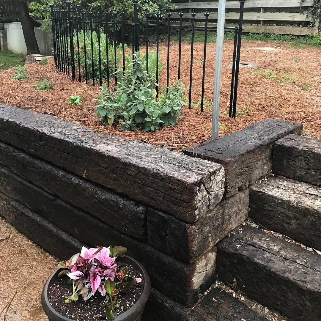 We Love Replacing Old Cinderblock With Railroad Ties It S Is Less Expensive And Adds Ch Landscaping Retaining Walls Landscaping With Rocks Outdoor Landscaping