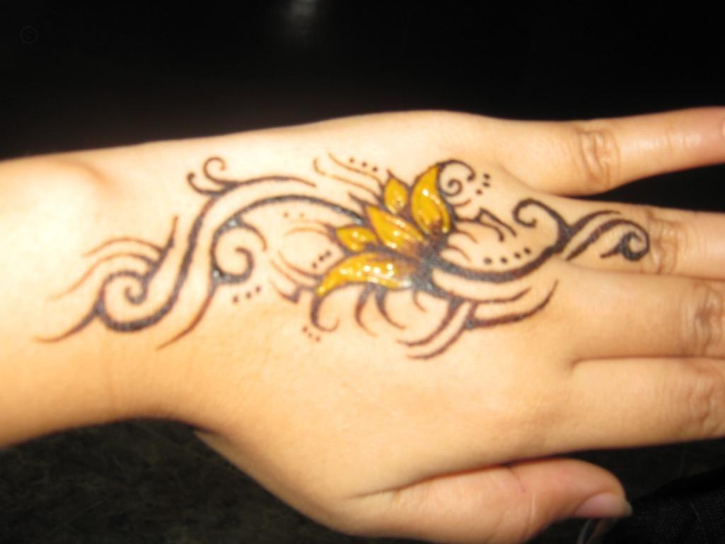 Hand tattoos tattoo ideas hands body art tattoo s floral tattoo - Hand Flower Tattoo Yellow Flower Tattoosyellow Flowersflower Tattoo Designshand
