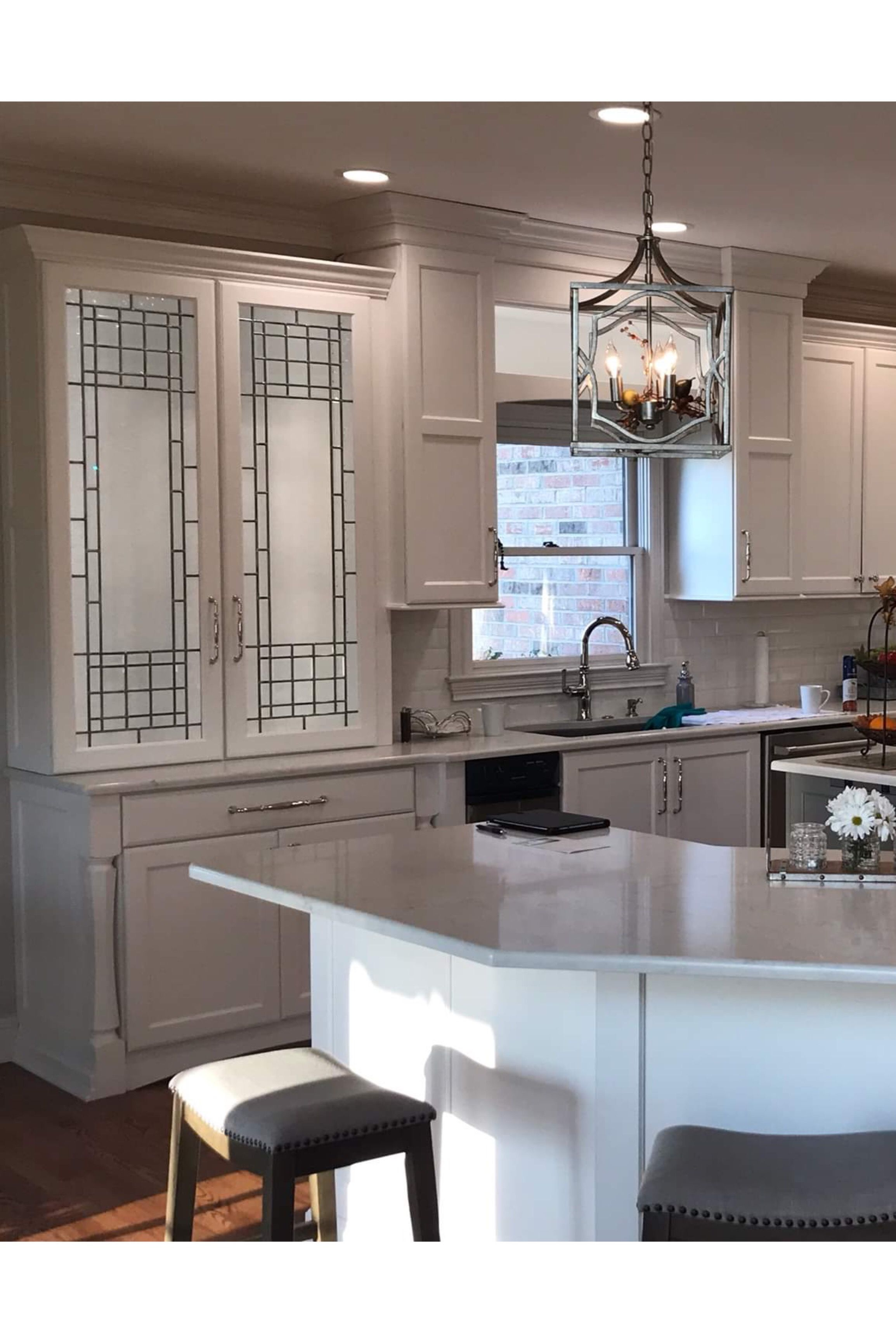 Modern kitchen remodel with leaded glass cabinets by Laura ...