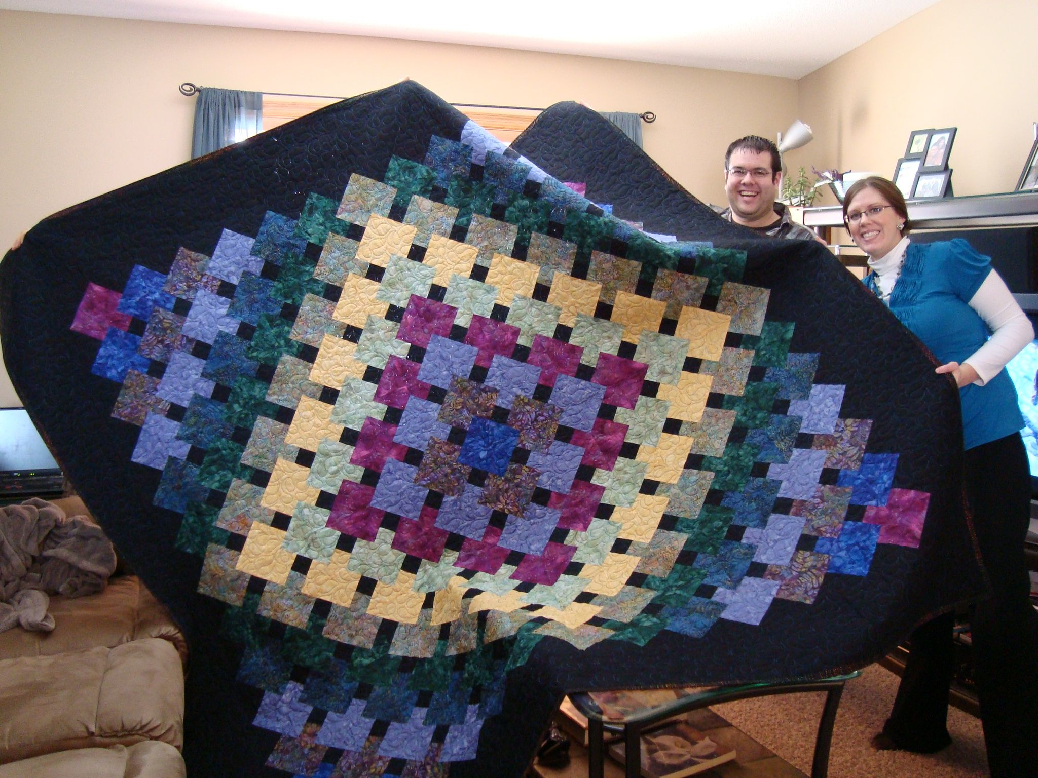 This is the wedding quilt I made for my son and his bride.  I paper-pieced it.
