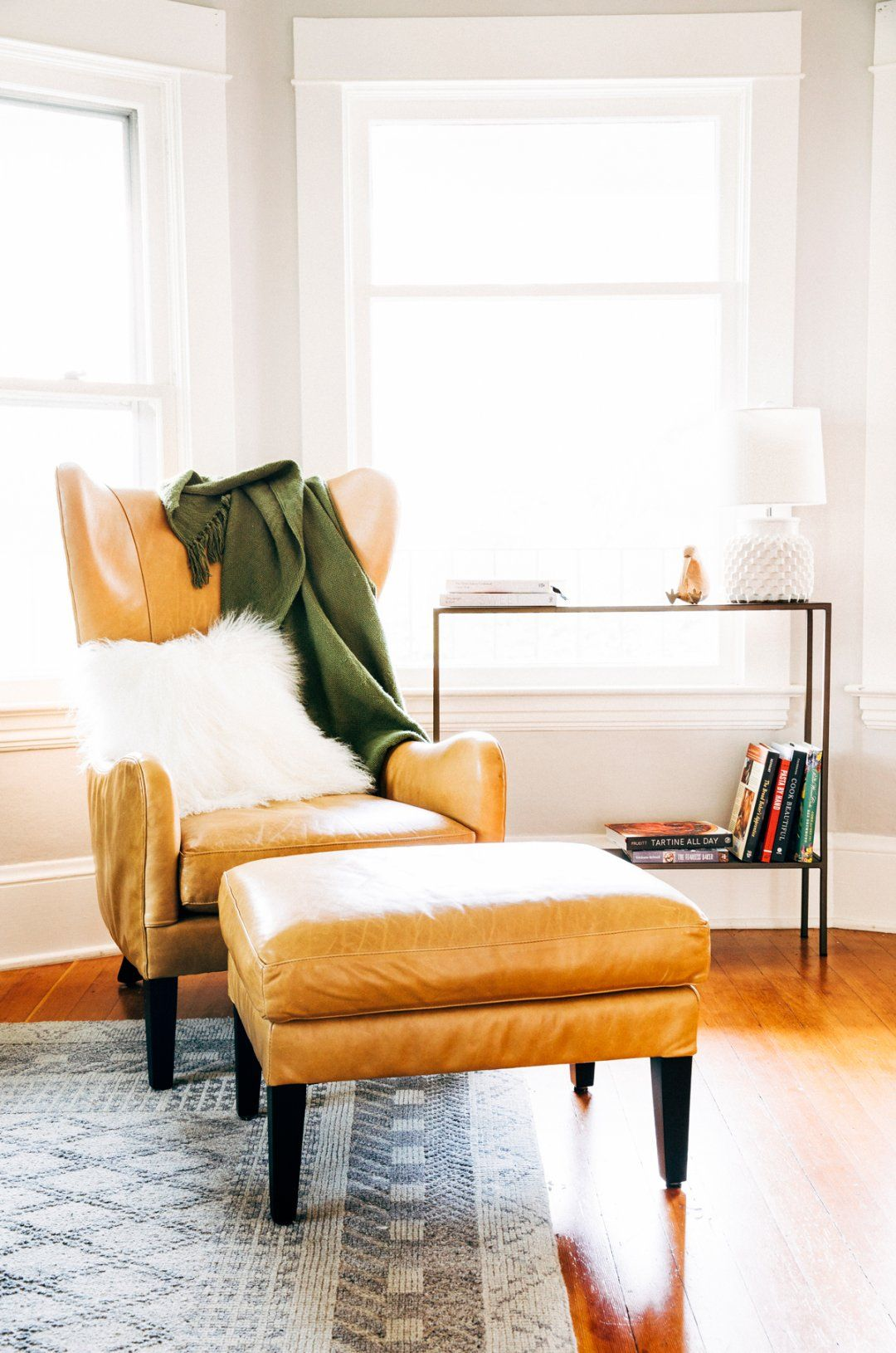Tan leather chair in front of big bay windows also how to style today homes pinterest home rh