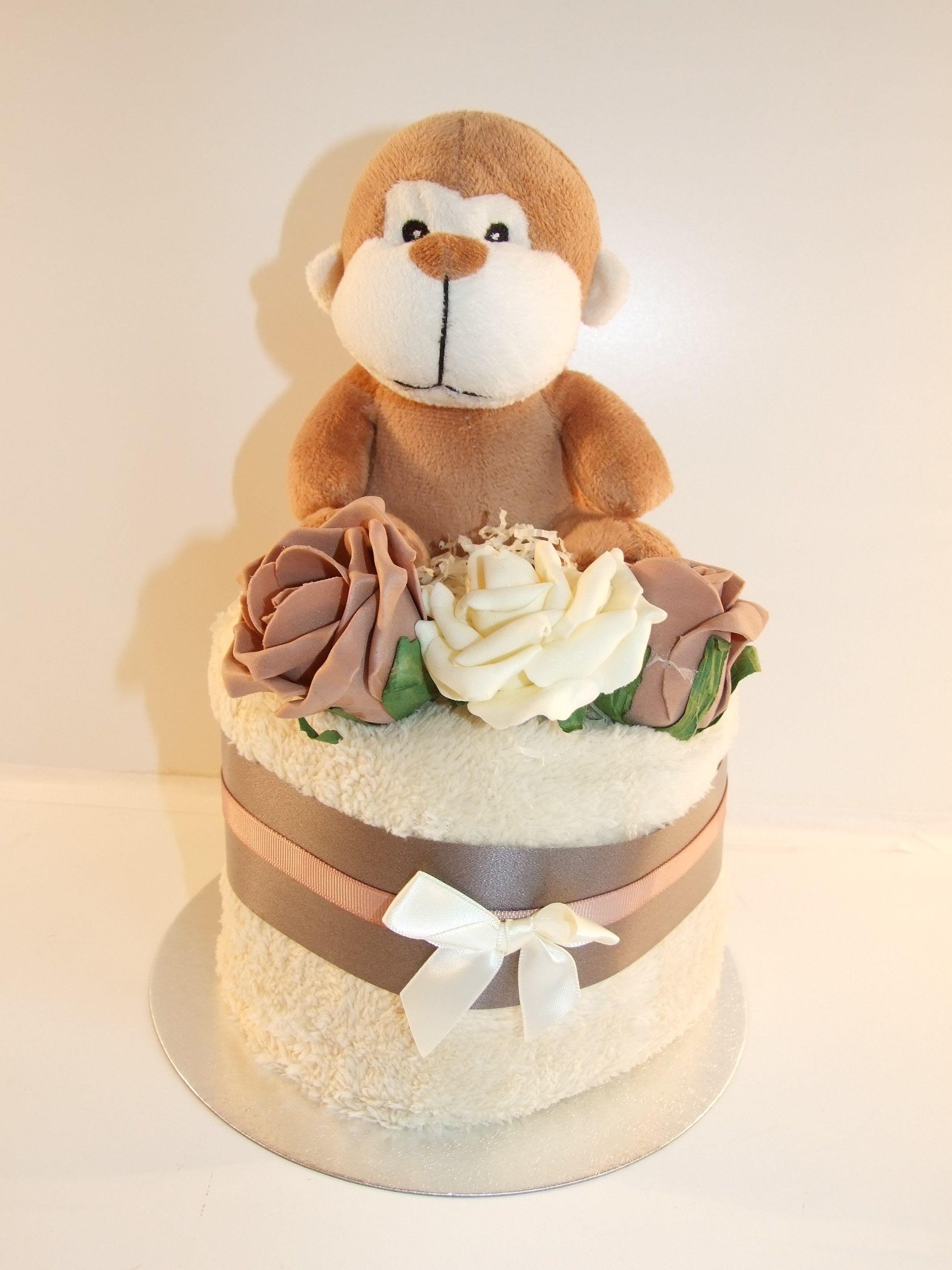 Cute monkey nappy cake - http://www.ebay.co.uk/itm/Nappy-cake-neutral-unisex-boy-or-girl-baby-shower-gift-present-brown-monkey-/191739679487?ssPageName=STRK:MESE:IT