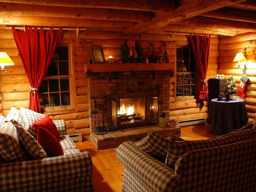 Living Room Decorating Ideas Log Cabin inviting living room with wood burning fireplace - west wardsboro
