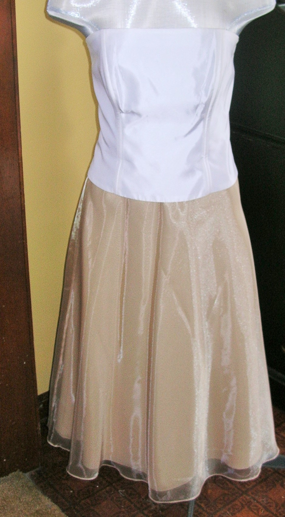 """Here I have a Michaelangelo bustier lovingly worn one time.  It is a size 8.  I do not have straps but the loops are there if you wanted to add some.  The listing is only for the top.  If you would like the gold skirt tagged David's Bridal, this is sold separately.  Follow this link to find the gold skirt.  Check out my other items!  I apologize for the manikin having a less than adequate frontage to fill out this garment.  The back measures 10"""" and the front is 14"""".  These measurements are…"""