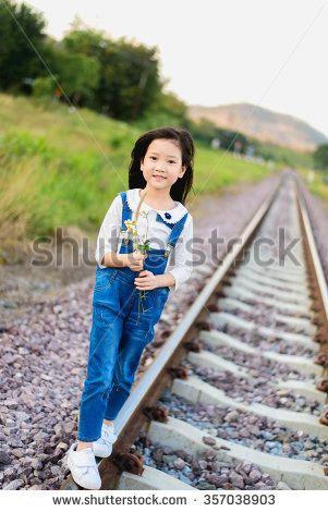 Selective focus on Asian young beautiful girl walking on the railway.