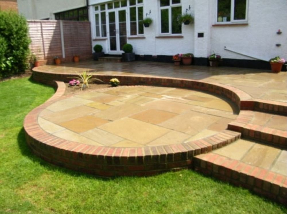 Beau Split Level Garden Patio In Sandstone Slabs