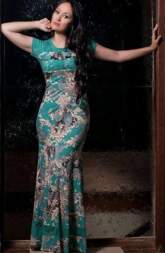 9df7167fd Vestido confeccionado em Malha com Renda trabalhada forrado, com estampa em  cor contrastante . Informações