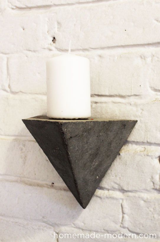 Faceted Concrete Geometric wall hooks. These fun and modern pieces can be scaled and re-purposed to serve a number of functions, from coat hangers to shelving. Courtesy of @Ben Silbermann Uyeda