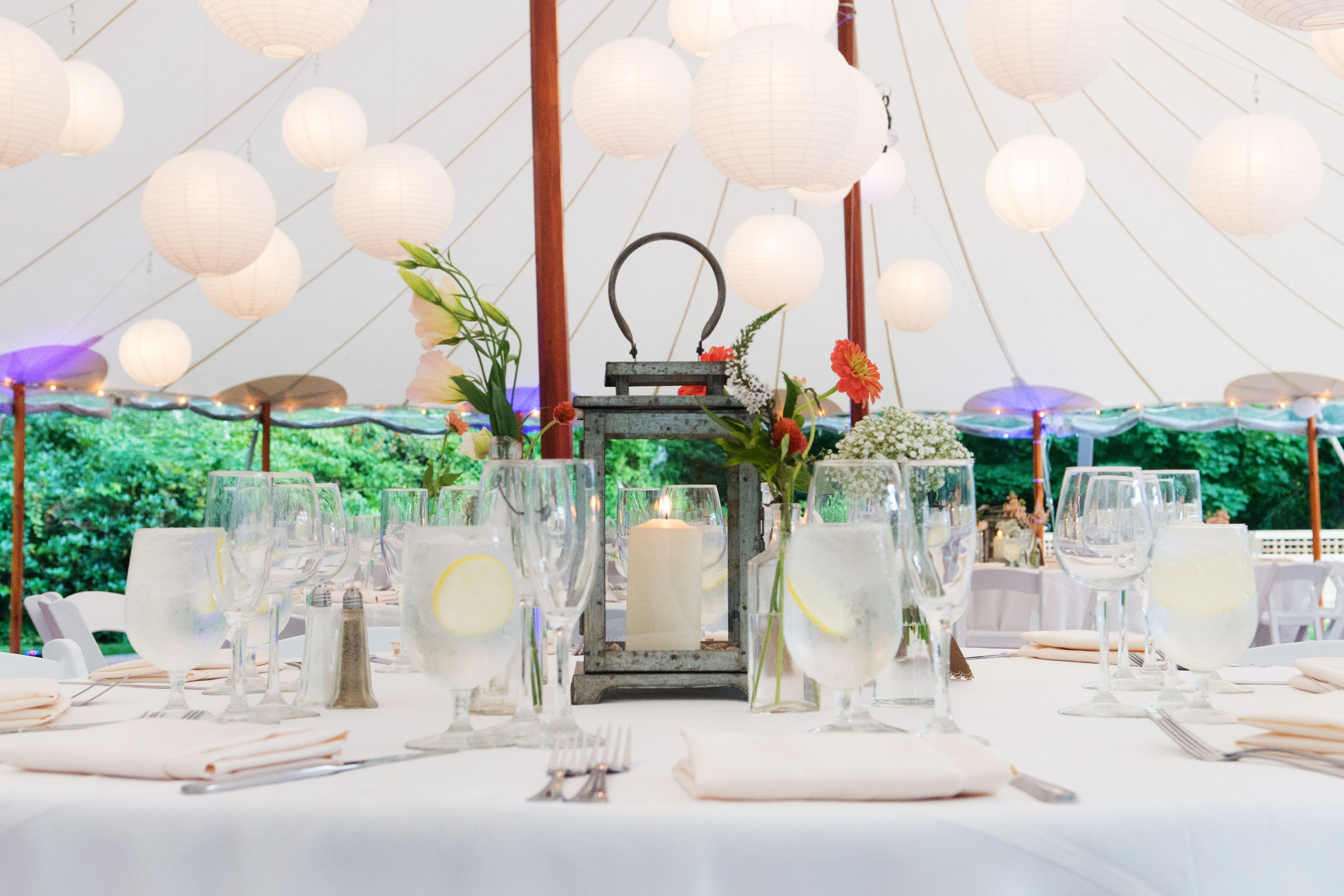 Tent reception with white paper lantern hanging lights. Rustic ...