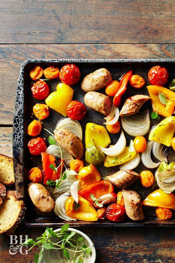 Chicken Sausage and Peppers #sheetpansuppers We love the ease of sheet pan suppers, and this one only needs 15 minutes of prep time! Your meat and veggies cook together to make a healthy meal that comes together fast. #recipes #recipeideas #sheetpandinner #chickensausage #easydinner #quickrecipes #weeknightdinner #chickensausageandvegetables #bhg #sheetpansuppers
