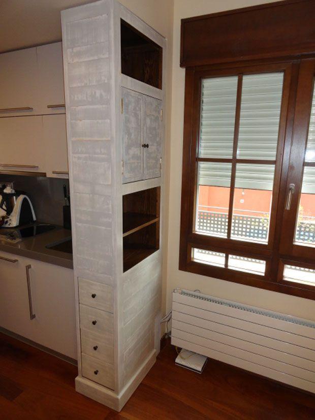 Mueble separador de ambientes en concreto la cocina de la for Muebles de cocina zona pilar
