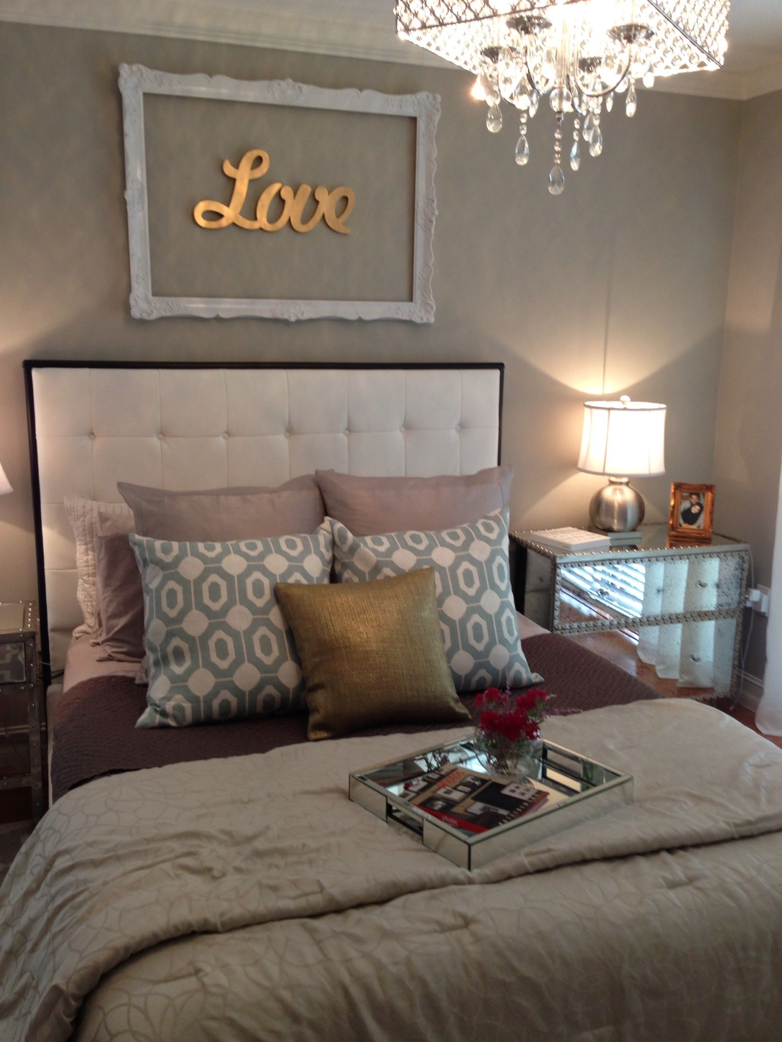 Bedroom Wall Decorating Ideas too many different colors but i love the decor above the bed