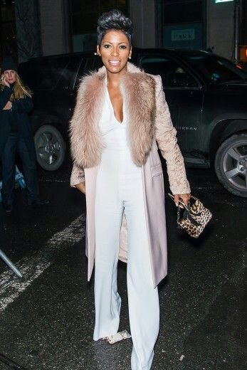 Nice coat over a white jumpsuit