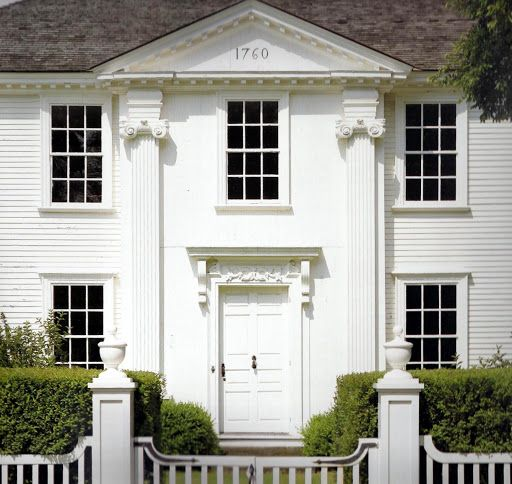 The Lady Pepperell House, Kittery Point, Maine, built in 1743, features a central pavilion with a triangular pediment, dentils, and Ionic pilasters, and a doorway embellished with consoles supporting a horizontal pediment.