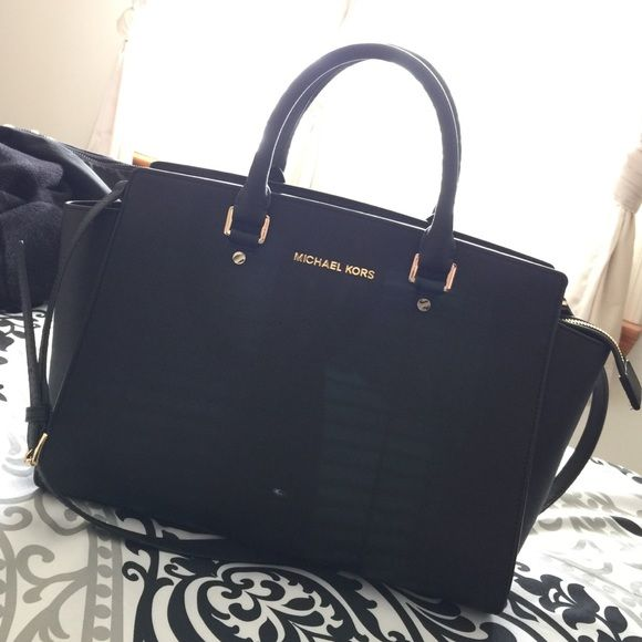 Authentic Large Black Michael Kors Selma Bag! Gorgeous bag! Can be used for any occasion. Has some small white marks on it but overall in great condition! Looks almost as good as new! Comes with long shoulder strap as seen in pic one. Price can be negotiable but I am not desperate to sell this bag so please send reasonable offers! Thank you, any questions? Comment below! NO TRADES DO NOT ASK. MICHAEL Michael Kors Bags