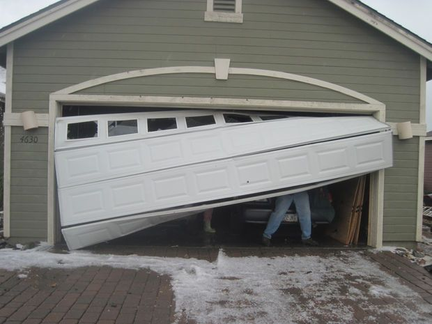 7 WAYS TO FIX A DENT IN A GARAGE DOOR PANEL
