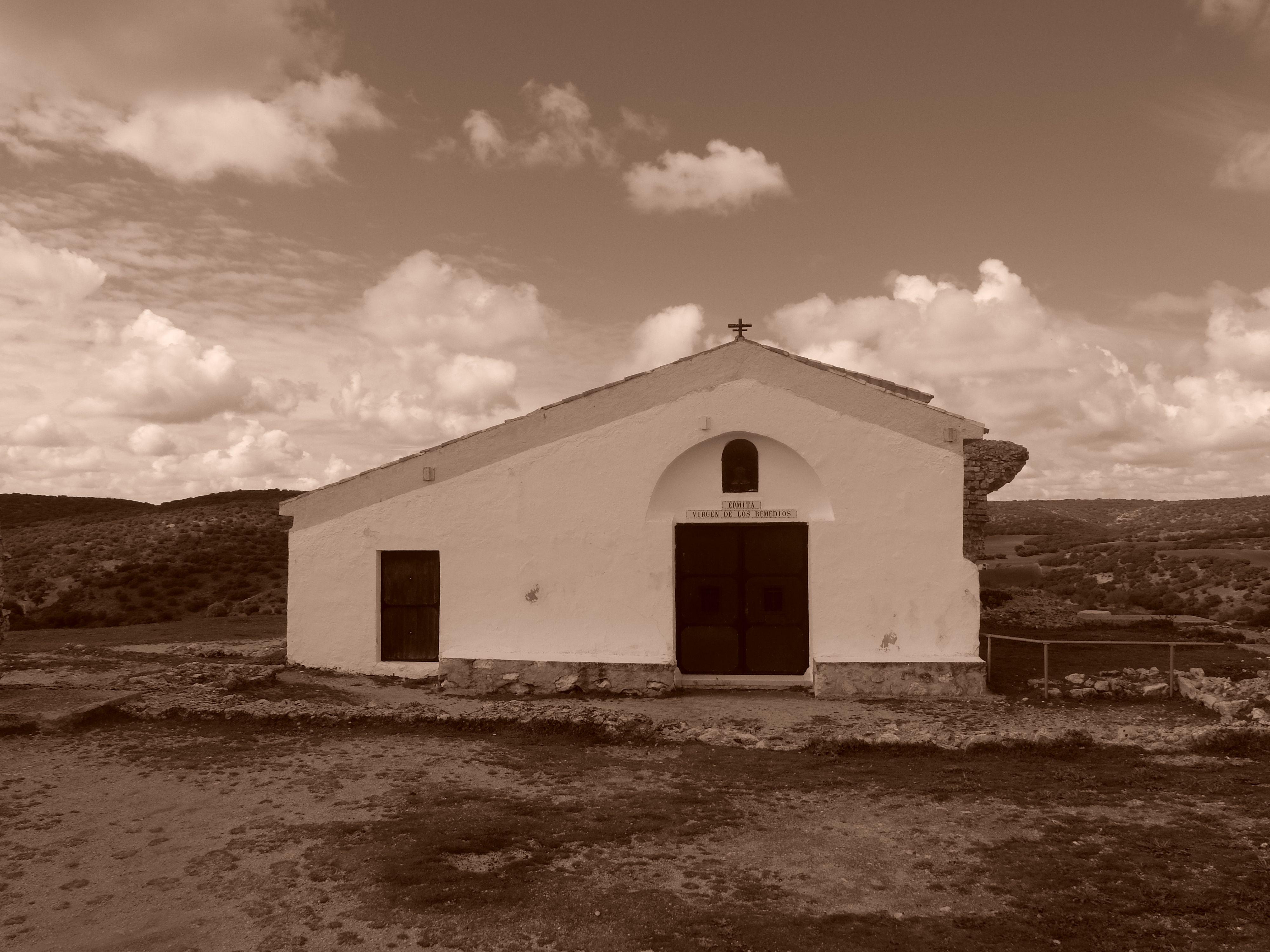 Ermita de San Bartolomé, también llamada de la Virgen de los Remedios. Situado sobre las termas romanas ocupa la parte mas alta del Cerro de la Cabeza,de Griego en el que se encuentra el yacimiento arqueológico de Segóbriga