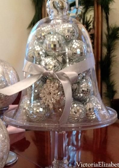Fill a cloche or cake dome with DISCO BALLS...  and other Christmas decorating ideas.