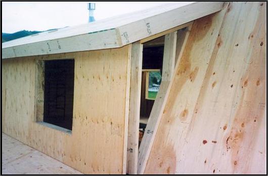 Log Home Shed dormer on Gambrel roof, standard framing used