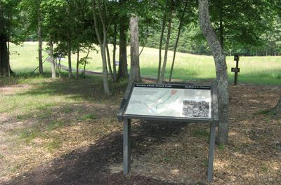 The marker is at the edge of the parking area at Stop Two on the Auto Tour next to the beginning of the trail