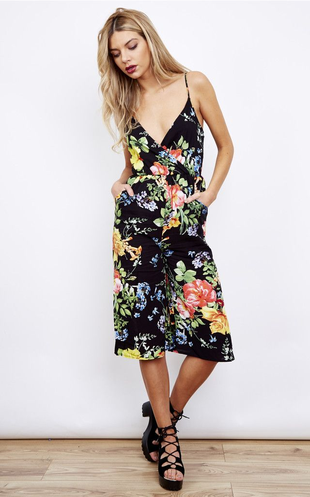6d005fc96206 We love this Black Tropical Floral Culotte Jumpsuit. With a black base and  bright flowers