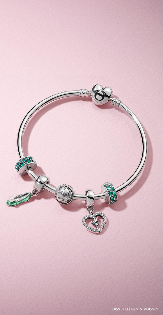 4377f778a Shine bright like Tinkerbell with the cute PANDORA charms inspired by the  iconic strong-willed Disney fairy.