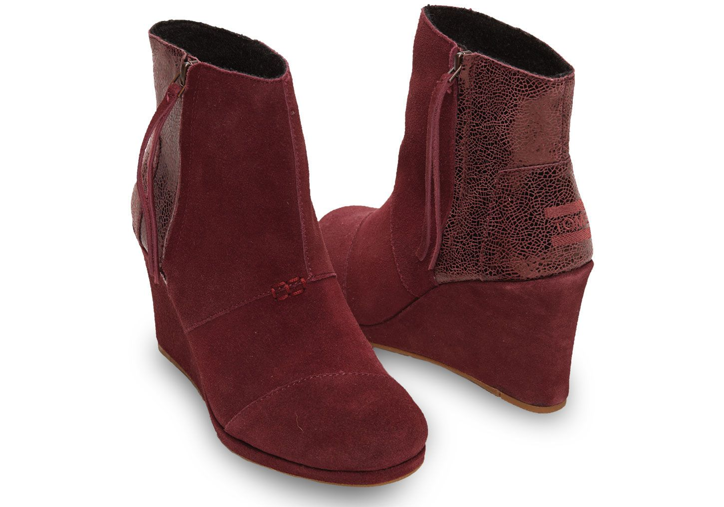 Wear TOMS Wine Crackled Leather Suede women's Desert Wedge Highs with an all-black outfit or pair with jeans and an oversized sweater for a festive outfit.