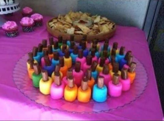 Nail Polish Bites:  large marshmallows dipped in frosting  and topped with a Tootsie Roll.