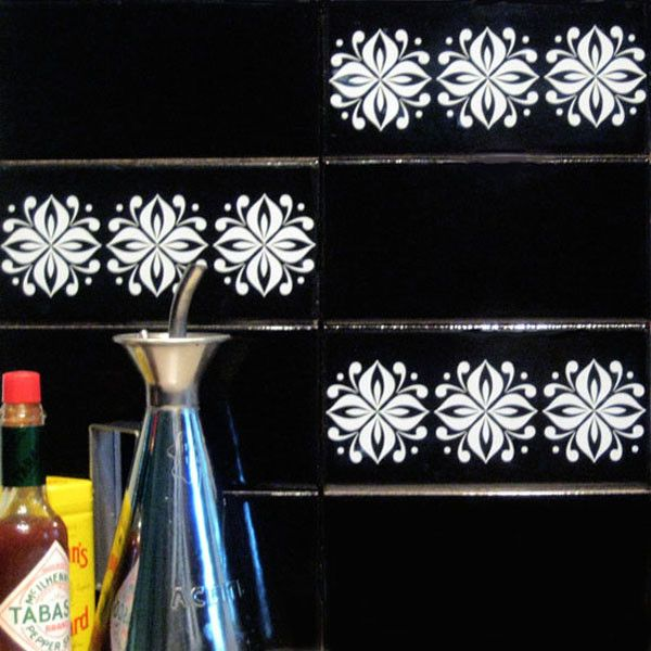 Tile Tattoos stickers hide ugly tiles in an apartments and peel