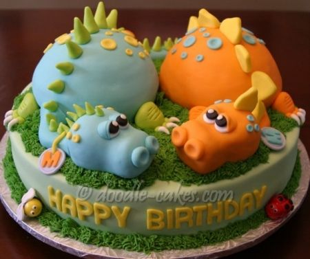 Dinosaur Twins cake DoodleCakescom Blue dino is chocolate cake