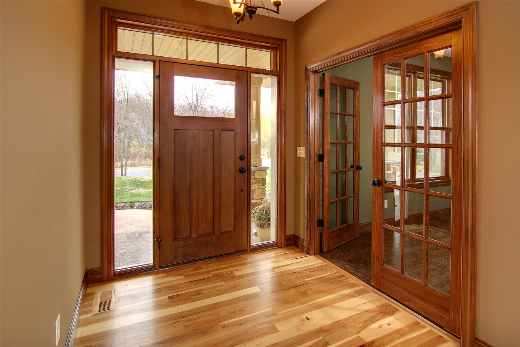 Hickory floor cherry stained doors and trim for the for Wood doors with white trim pictures