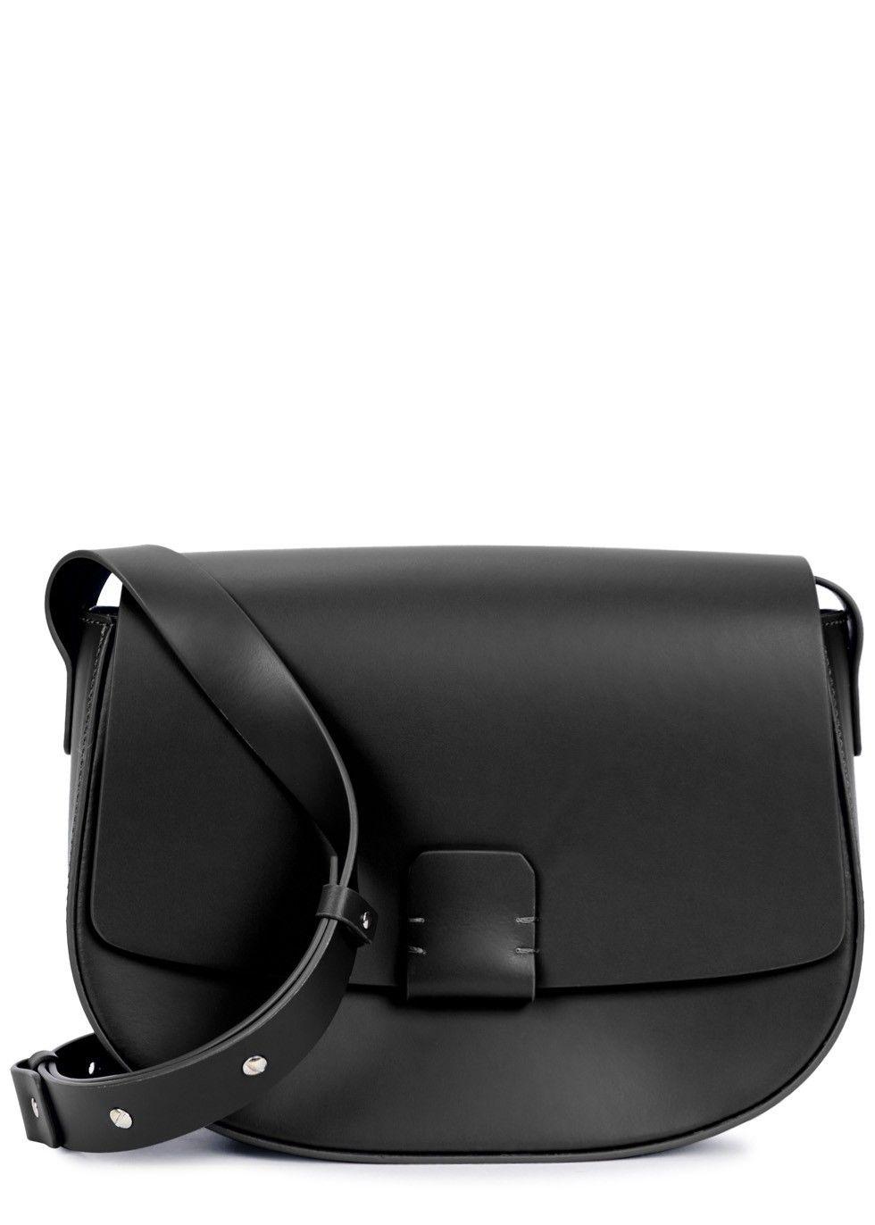 96cb74dfb54 Nico Giani black leather saddle bag Adjustable shoulder strap, internal  slip pocket, fully lined Concealed magnetic press stud-fastening tab at flap  front ...