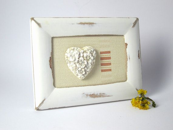 Shabby chic white frame with heart of gypsum and novelty cream ...