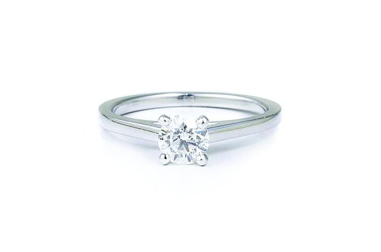Set with one circular-cut diamond, weighing approximately 0.35 carat; signed DeBeers DB950 B23734; ring size 4; weight 2.8g.