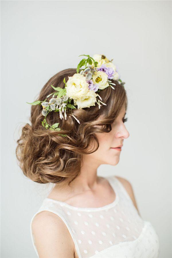 Romantic Long Wedding Hairstyles Using Flowers Low Updo - Wedding hairstyle romantic with flowers
